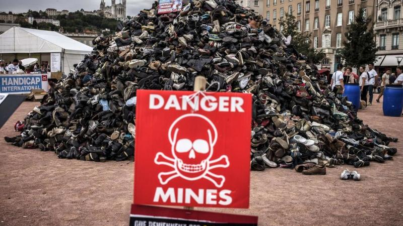 A pile of shoes during the annual demonstration by NGO Humanity and Inclusion denouncing antipersonnel landmines and cluster munitions in Lyon on September 20, 2014. © 2014 Getty Images